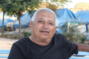 [Image description: photo of Nabil Y. Masri. He is smiling at the camera.]
