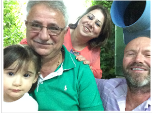 [Image description: selfie of Fr. Chris and Waze, and two of his family members.]
